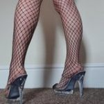 Does she look good in fishnets